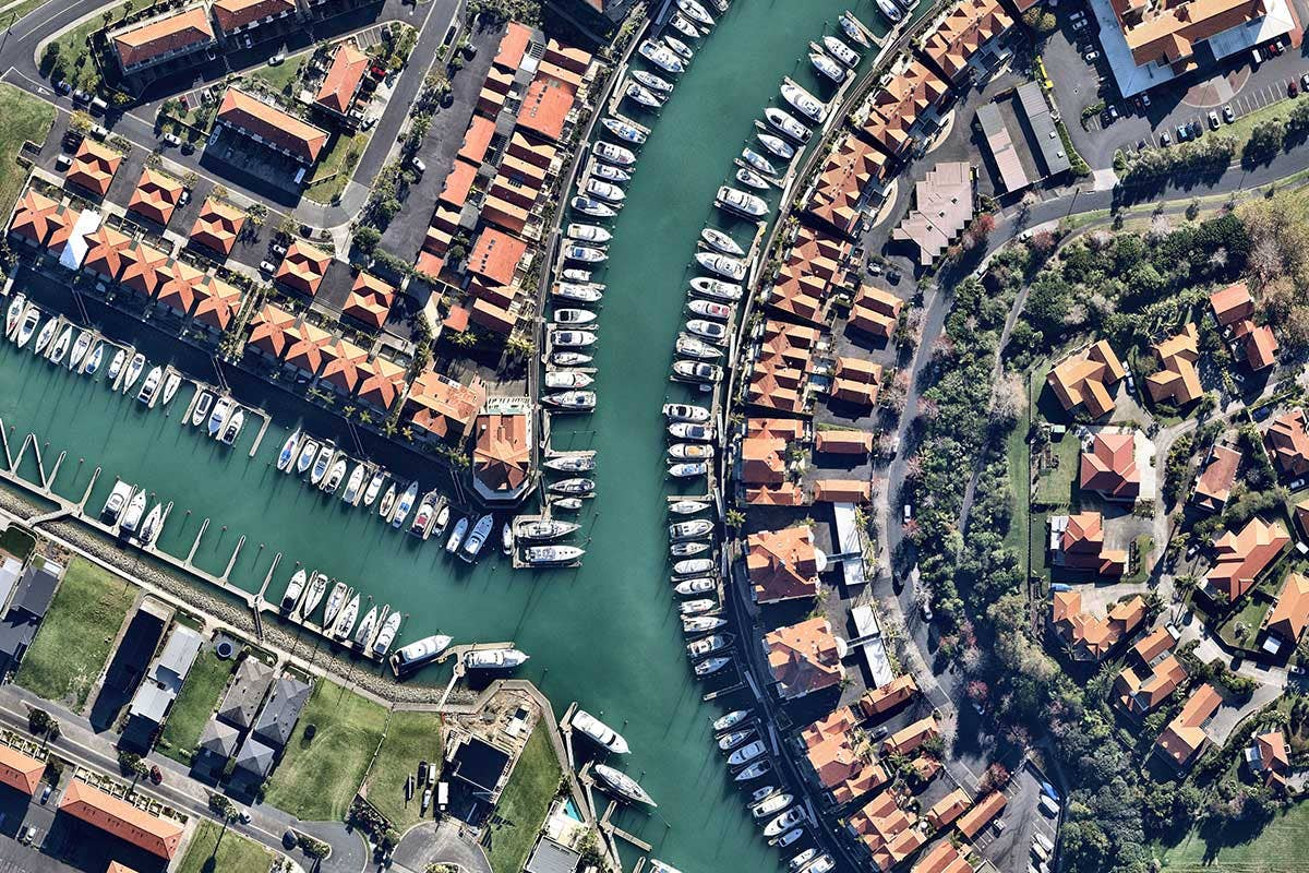 Aerial waterside marina in Gulf Harbour in Whangaparaoa, Auckland