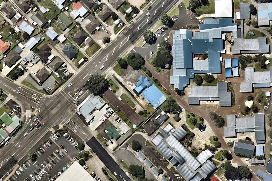 aerial image of layered school roofing in tauranga-- 7 January