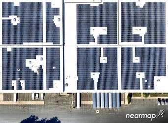 Aerial view of Pharmasol Corp. solar array in Stoughton, MA -- 7 July 2018
