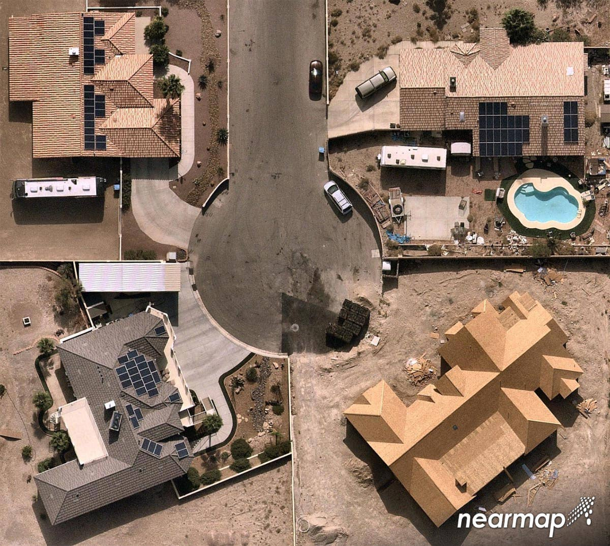 Orthographic aerial view of Las Vegas, NV cul-de-sac with solar homes and one under construction -- 5 July 2018