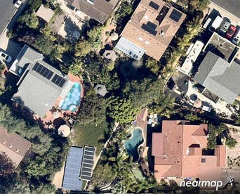 Overhead aerial view of solar array and neighborhood installations -- 21 June 2018
